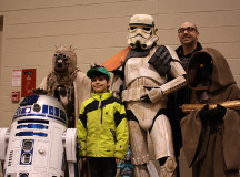 Stormtroopers, Tuskan Raiders, Jawas, and even R2-D2 pose with fans.