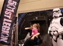 The 501st legion, a group of cosplaying Star Wars characters, brought a piece of the deathstar with them to Comic-con, letting people sit on the Emperor's throne.