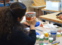 Ceramics student puts finishing touches on artwork