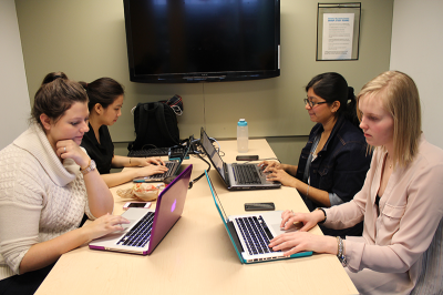 Advertising students, from left, Caitlin Vollum, Victoria Hoang, Sunaynna Venkatesh and Jodi Harvey hope to get enough votes from the public to move on to the next round and win the ASC competition.