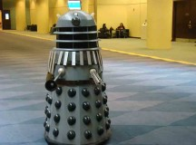 Dalek trying to exterminate the patrons at comicon