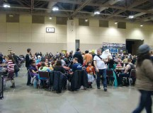 Hugger fans devouring their lunch so they can get back to the convention floor