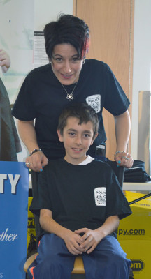Lorraine Cipparrone gets ready to shave her 10-year-old son, Daniel's, head.  He was the first volunteer to get his head shaved.