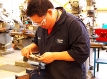 Craig Hoo works on a project in the Tool and Die lab.