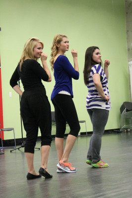 From left, Mélanie Paiement, Kelsey Lacombe and Ainsley Roy, sing Take a chance on me by ABBA at one of the rehearsals.