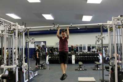 Adrien Green doing chin-ups at Trafalgar Campus' gym.
