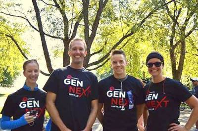 Geoff Gibson on the left and Mitchell Bonk on the right stand between their two other teammates after the Terry Fox Run on Sunday,
