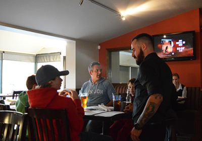 A waiter takes a family's orders at Philthy McNasty's Sports Pub on Speers road.