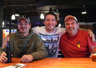 From left to right, Dennis Danally, Andy Gilpin, and Darin Tucker spoke on the hiked drinking ages at Shakers bar after having finished work.