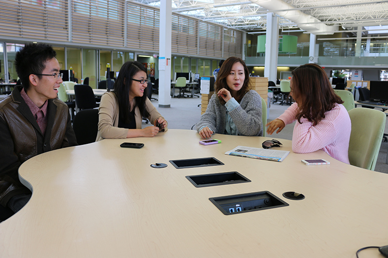 Adison Winne, 22 left, Die Zhang, 23 next to Winne, Miji Lee, 24, and Shinhee Kang,20  last, having a conversation