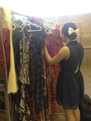 Morgan Squibb searches the racks for a one of a kind find at the Sheridan Theatre wardrobe sale.
