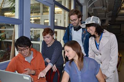 From left, Eustace Ng, Lilja Pétursdóttir, Sarah Goran, Joe Marcy and Louise Liu, looking over their short animation, 'Dig In'.