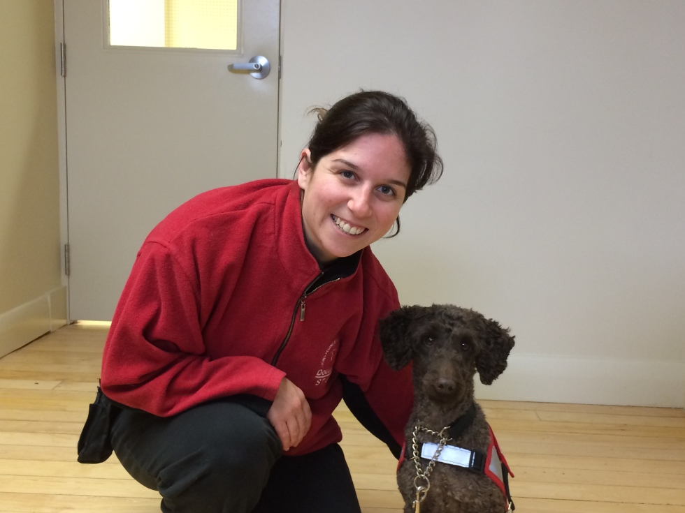 Trainer Angela Bentivegna poses with one of her assigned dog guides on Nov.6 at the Lions Foundation facility in Oakville.