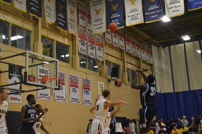 Brian Owusu pulls up for a three pointer early in the shot clock.
