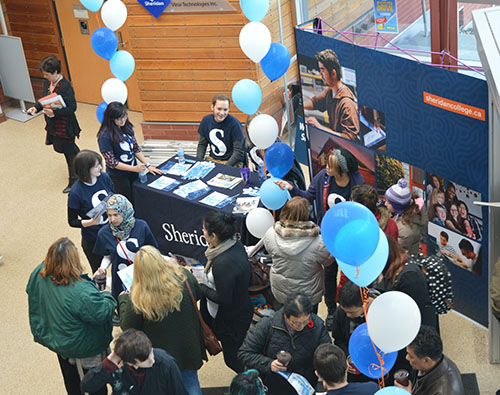 The SCAET building was filled with guests during Sheridan's Open House on Saturday, where booths were set up to represent each program.