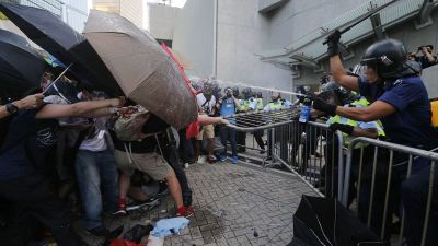 During the September protests in Hong Kong, police sprayed activitsts with tear gas when all they had to protect themselves were umbrellas. (Tyrone Siu / Reuters)
