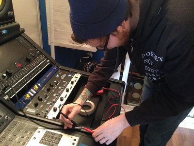 Nick Ginn does some last-minute tinkering for the School House Studio's first episode of it's new live series.