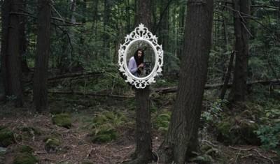 Darren Rigo's selfie taken in Canadian forestry, photo taken by the artist.