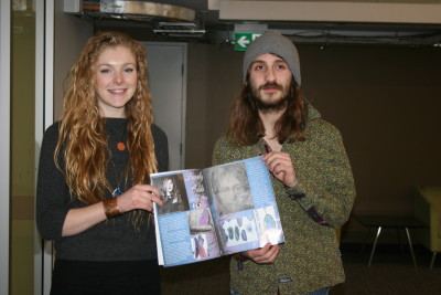 Travis Stedmond and Kelly Crozier hold up a printed copy of the first issue of Synergy magazine. Photograph by Chanelle Fagon-Turner