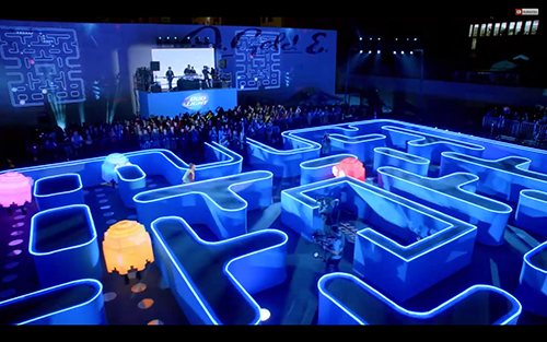 A scene of Pac Man being chased by the ghosts Pinky, Inky, Blinky and Clyde inside a life-sized maze during a real game of Pac Man.