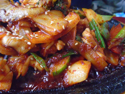 A spicy squid dish from the Owl of Minerva that's great to order have when you've got the flu.