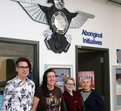 Elijah Williams, Kayla Parisien, Meagan Byrne and Paula Laing stand outside the Aboriginal Initiatives Office at Sheridan.