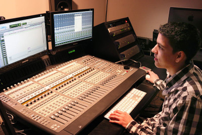 (Photography by Brittany Preocanin) Daniel Moctezuma, a third-year Bachelor of Film and Television student, at work in the audio room.