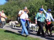 Dog walkers start off the 2k walk around Kingsford Park on Sunday.