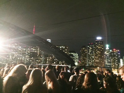 Students on the upper-level Skyline Deck dance floor. The CN Tower and other T.O. buildings added to the party atmosphere.