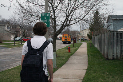 Conrad Hogg starts his first day of school as he walks to the bus.