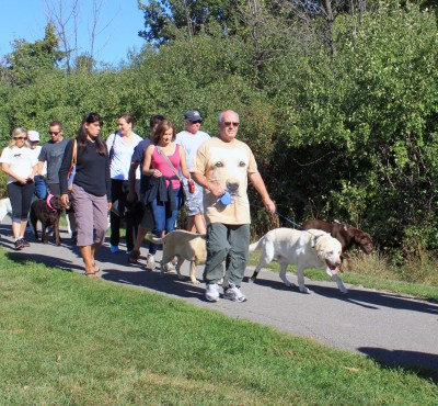 Andrew Neil and his dog start off the annual 2k dog walk around Kingsford park for Labrapalooza.