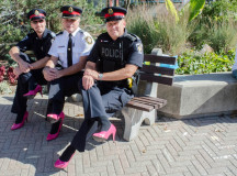 Halton police pose for a shot of their hot pink heels before the Hope in High Heels walk.