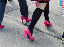The pink heels clacked on the pavement as men walked to raise awareness for violence against women and children.