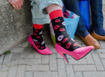 Bob Lush, 77, sports his pink high heels with fancy socks at the Hope in High Heels awareness event.