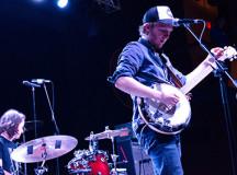Lawlor tuning the banjo.