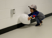 Rio Rospoli, 3, running around the halls with his balloon. (Photography by Courtney Blok /The Sheridan Sun)