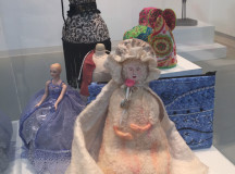 A doll display in the fibre arts gallery. (Photography by Courtney Blok / The Sheridan Sun)