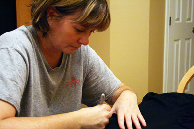 Joanne Thompson works on her sons Darth Vader costume from scratch.