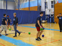 Students join the Sheridan Student Union for a fun game of kings court dodge ball inside the gym.