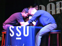 On the stage at the Marquee, Abdullah Saleh and Devin Rintoul, compete in the first arm wrestling match at Healthy Heart Day.