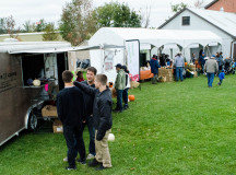 Food trucks and agricultural booths were on display in the Simply Local Farmers Market with fruits, vegetables, and honey jars for purchase.