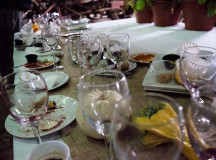 The empty plates and glasses from guests inside the Harvest Halton barn.