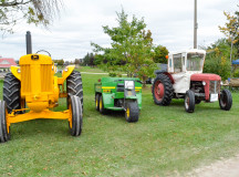 The farm implements display included tractors young and old.
