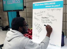 Oluwabiyi Akimsara, a second-year Software Development Network Engineering student, writes what he thinks wellness is on the ideas board.