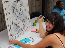 Akita Cachia'costa, a third-year Illustration student, exercises her brain by completing a Sudoku puzzle.