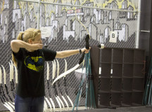 Trainer Sarah demonstrates how to accurately and safely fire the bow and arrow to the group