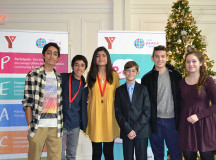 Group medallion winners Ishan and Vishal Vijay, founders of EveryChildNow, youth medallion winner Aiza Abid, youth nominees David Vidicon and Jack Mogus and master of ceremony Emma Mogus.