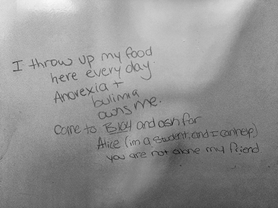 Last month inside a women's washroom in the SCAET building a message was written on the inside of a stall. The next day there was a response. Later in the day the stall was cleaned.