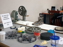 Tables filled with film reels and equipment were set up in the Mississauga Central Library.