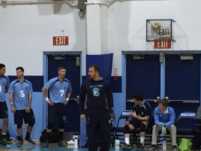 Coach Pento pacing on the sidelines as he watches his team